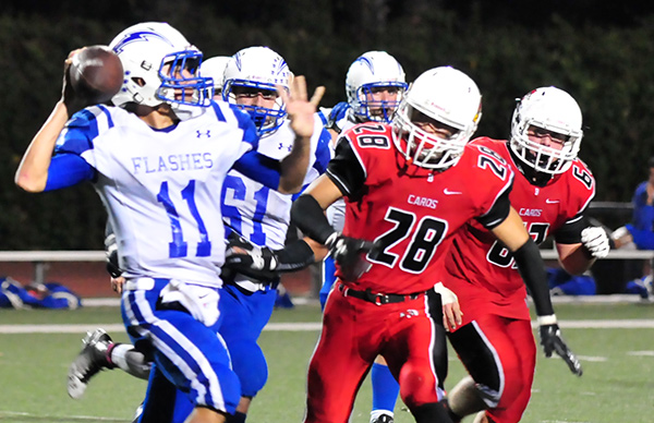 The Bishop Diego pass rush chases down Fillmore quarterback Carlos Briceno. (Presidio Sports Photos)