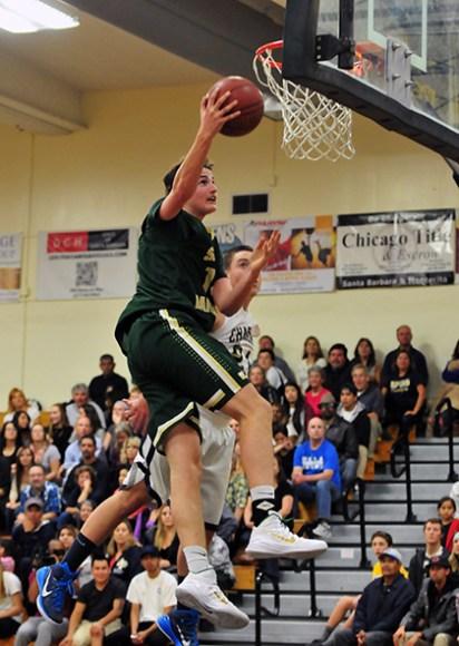 Santa Barbara High's Nick Busch gets to the rim for a basket.