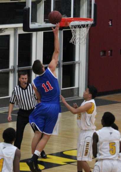 Scott Everman drives in for two of his 19 points in San Marcos' CIF playoff win over Firebaugh.