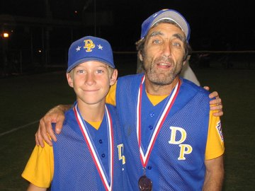 Dylan Rohde shares a championship moment with Coach Buddy in 2006  (Courtesy of Rohde Family)