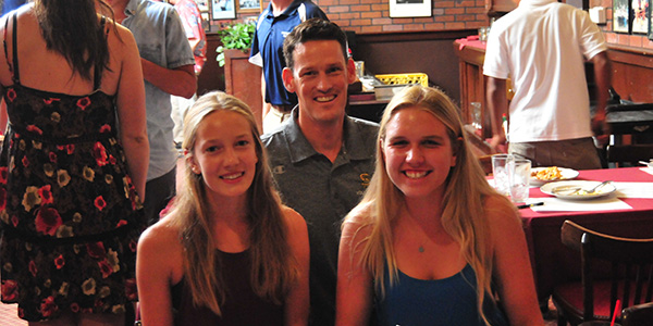 Santa Barbara High volleyball coach John Gannon with his sophomore standouts Linnea Skinner, left, and Erika Foreman.