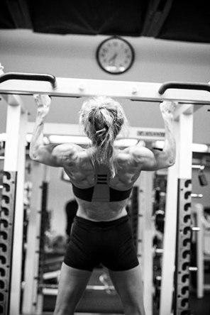 Suzanne in the weight room training for competition. (Grimmesey Photo)