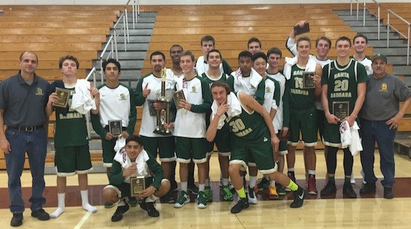 Santa Barbara High boys basketball team celebrates winning the Simi Valley Tournament title.