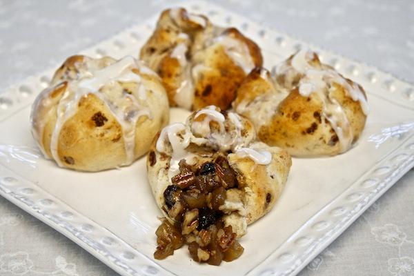 Apple raisins cinnamon knots topped with sweetened condensed milk