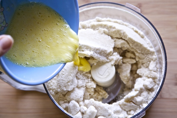 Pour almond and egg into almond cookie dough