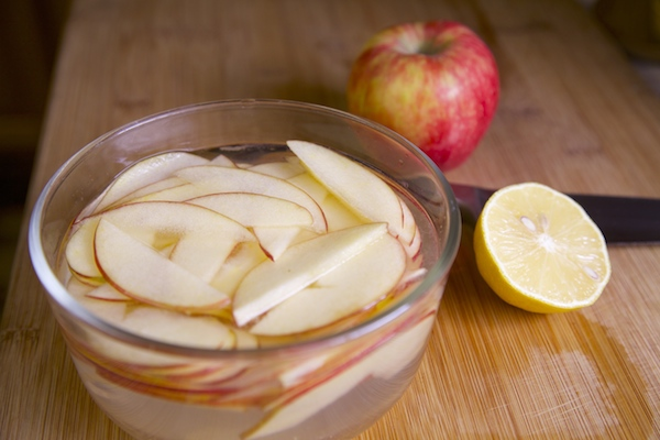 Sliced apples in bowl of water