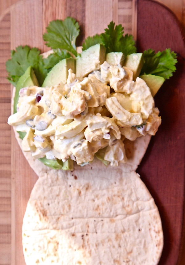 Scoop spicy egg salad over avocado on flatout flat bread.