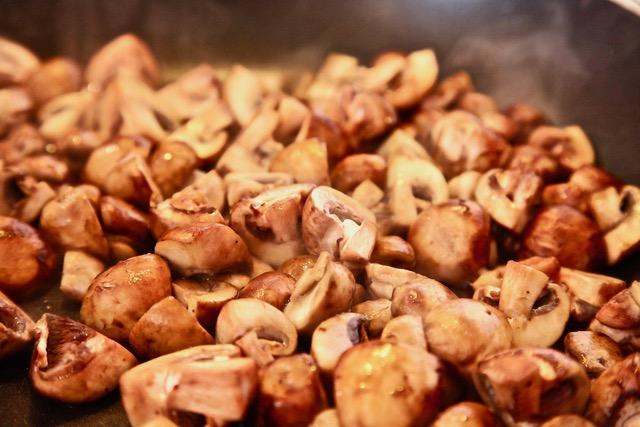 baby bella mushrooms cut in fours and sauteed for vegan menudo