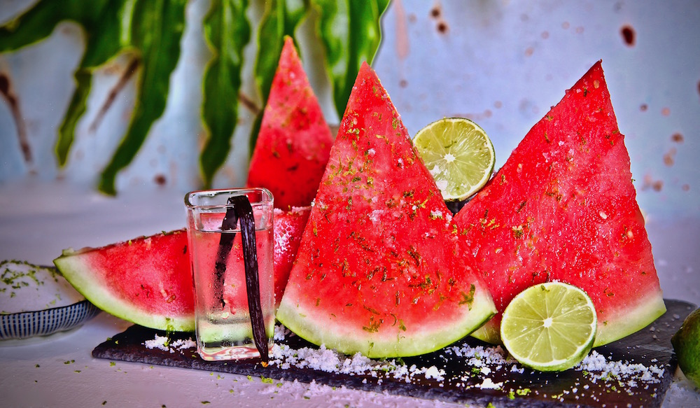 Vanilla vodka infused watermelon sprinkled in lime sugar is the perfect deconstructed cocktail to serve at your next party.