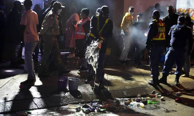 Photos: Police raid Soweto, taverns shut down and litres of alcohol poured out