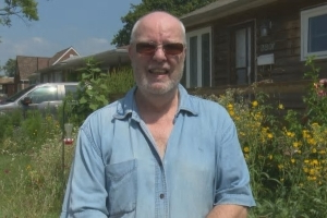 Windsor city hall says resident needs to trim his wildflower garden — he disagrees