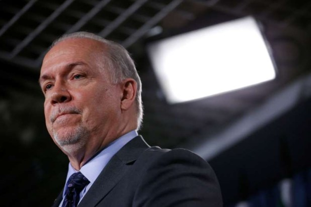 File picture.  British Columbia Premier John Horgan takes part in a news conference about the state of the Kinder Morgan pipeline expansion on Parliament Hill in Ottawa, Ontario, Canada, April 15, 2018.