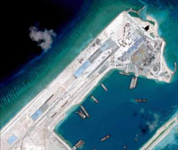 Airstrip construction on the Fiery Cross Reef in the South China Sea is pictured in this April 2, 2015 handout satellite image obtained by Reuters on April 16, 2015. Recent satellite images show China has begun building its first airstrip in contested territory in the Spratly Islands in the South China Sea and may be working on another, a leading defense publication reported April 16, 2015.