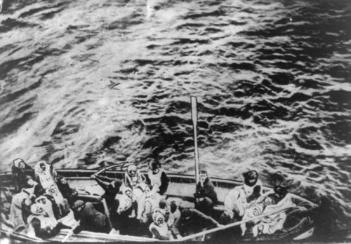 Survivors of the sinking of the RMS Titanic approach the RMS Carpathia in this April 15, 1912 photo