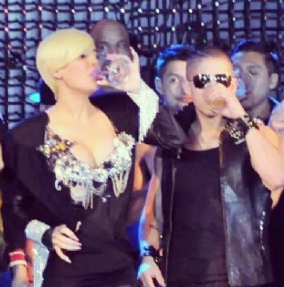 Jesse Medeles hanging out on stage with Ivy Queen.