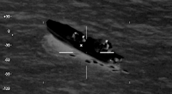Coast Guard image of seizing a drug smuggling speed boat off of Puerto Rican coast