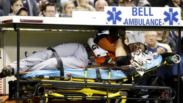 Giancarlo Stanton is carted off the field after being struck in the face by pitch