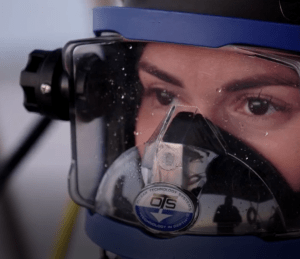 a woman is wearing underwater face gear