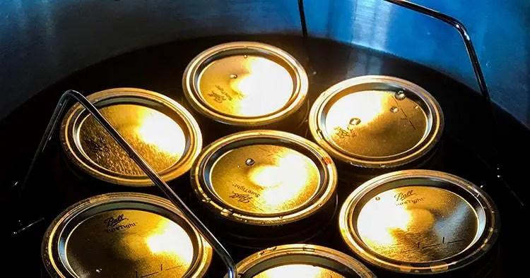 Canning jars in pressure cooker water bath