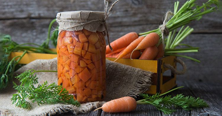 Fresh carrots in a glass jar,cooking vegetarian food.