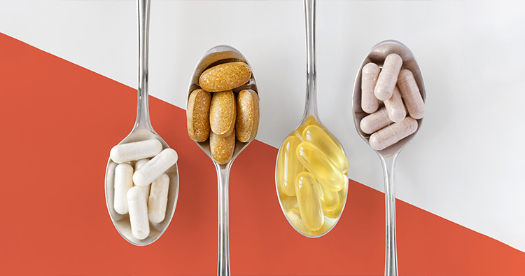 healthy-supplements-on-teaspoons-against-colorful