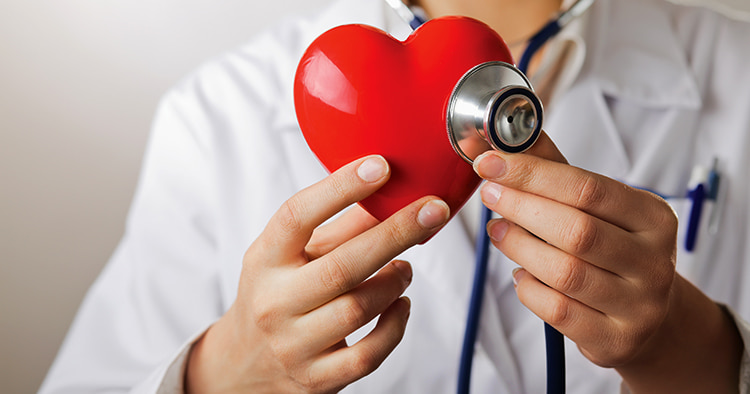 doctor-stethoscope-examining-red-heart-isolated