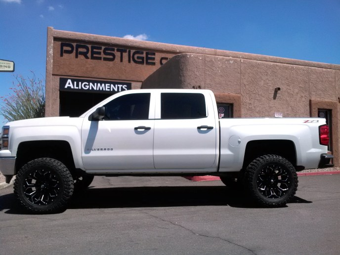 2014 CHEVY 1500 4X4 WITH A 6 BDS SUSPENSION LIFT KIT AND A SET OF 35 TIRES WITH 20 WHEELS (3)