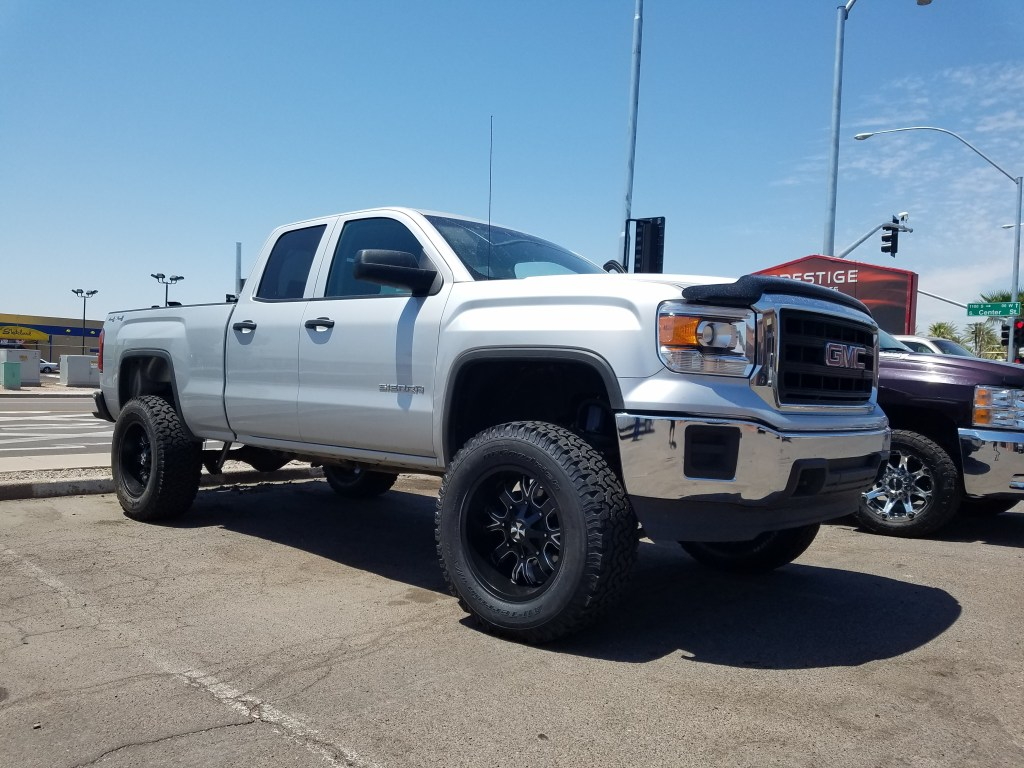 2014 GMC 1500 4WD WITH A 6.5 ROUGH COUNTRTY SUSPENSION LIFT KIT AND A SET OF CALI OFF ROAD 20X9 BLACK AND MILLED WITH BFG AT KO 32560R20 (1)
