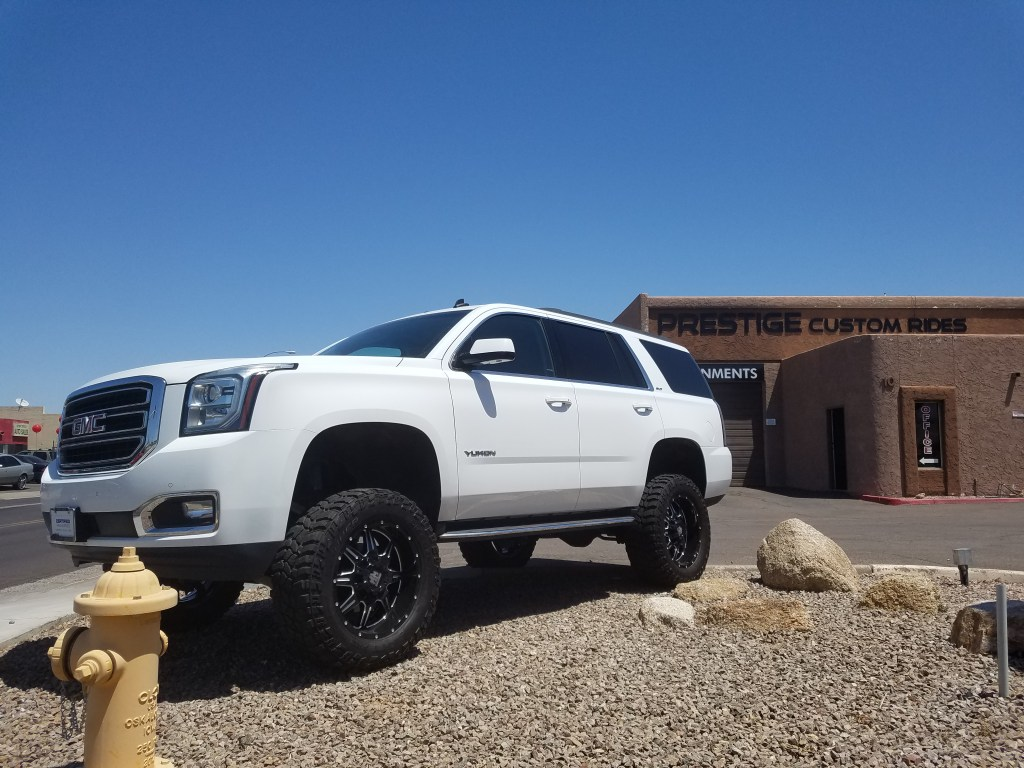 2015 GMC YUKON 4WD WITH A 7.5 ROUGH COUNTRY SUSPENSION LIFT KIT AND A SET OF MAYHEM MONSTIR 20X9 BLACK AND MILLED WITH 35X12 (3)