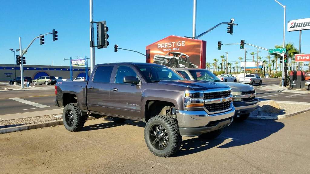 2016 CHEVY 1500 4WD WITH A 7.5 ROUGH COUNTRY SUSPENSION LIFT KIT AND A SET OF COOPER STT PRO MTS 35X12.50R20 AND CALI OFF ROAD DIRTY 20X9 BLACK AND MILLED (1)