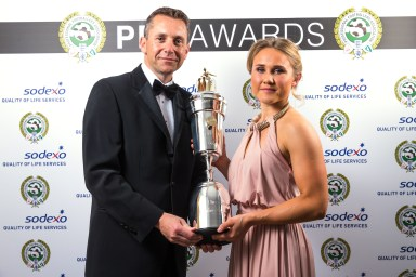 Izzy collecting her award from Sodexo Sports & Leisure CEO Chris Bray in 2016