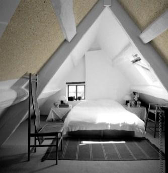 Modern double room under the eaves. --- Image by © Peter Woloszynski/Arcaid/Corbis