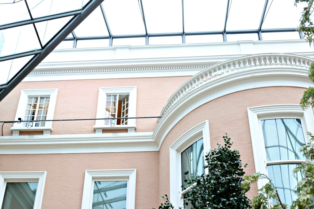 Picture of the Wallace Museam glass roof and beautiful pastal pink brick walls with white trim.