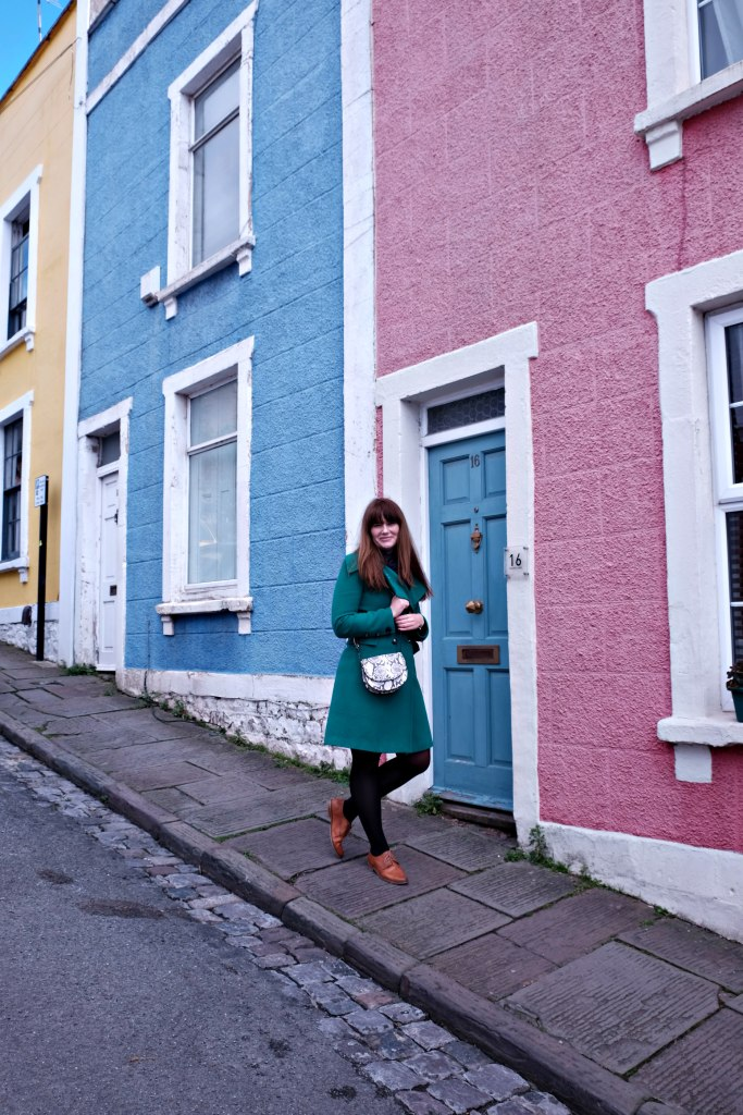 Picture of me in front of colourful houses of clifton, bristol.  48 hours in clifton itinerary.