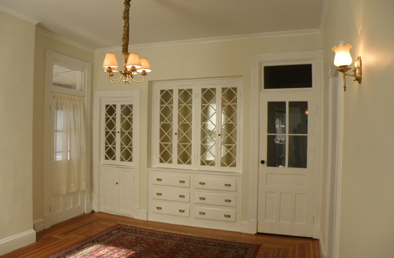 Built-in china cabinets fill one wall of the dining room
