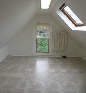 Bedroom with skylight in Schenectady apartment