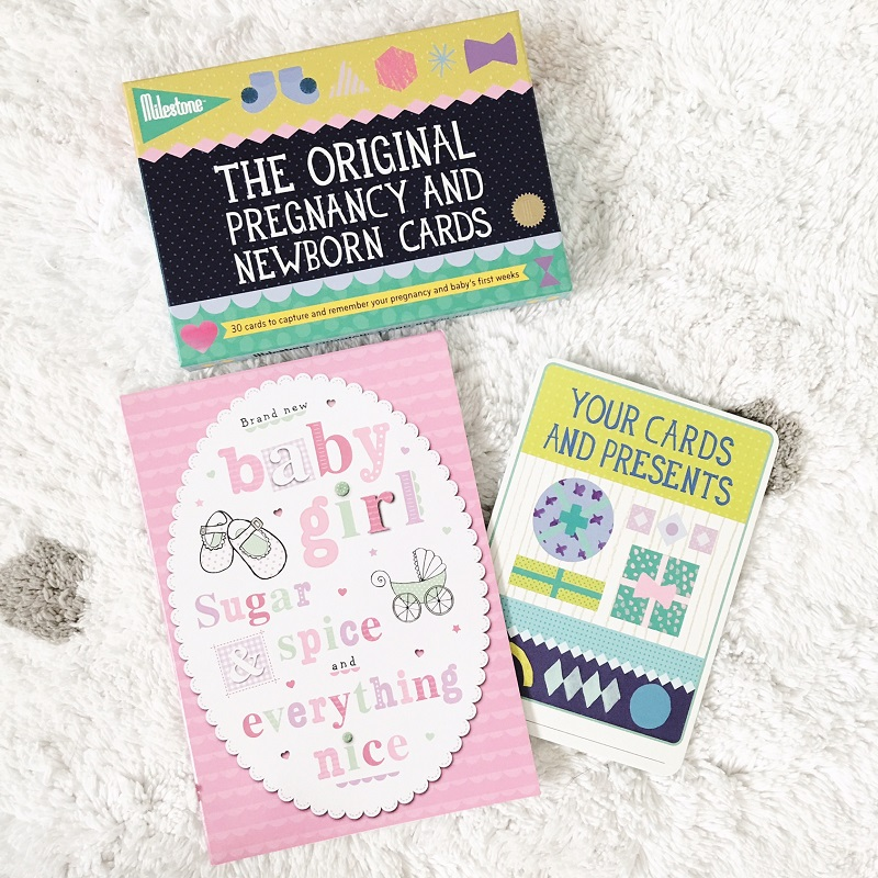 Milestone Baby card flatlay