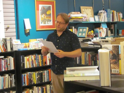 Jason Peck reading his fiction at Classic Lines Bookstore. You can read his fiction in Issue 5.
