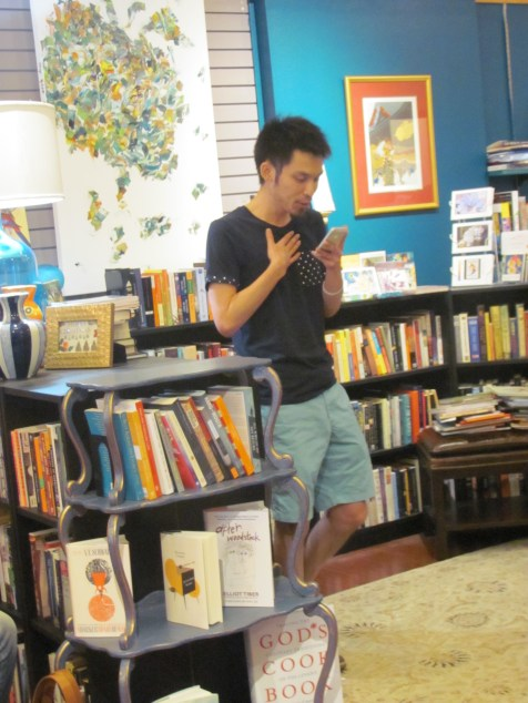 Kazumi Chin reading his poetry at Classic Lines bookstore.