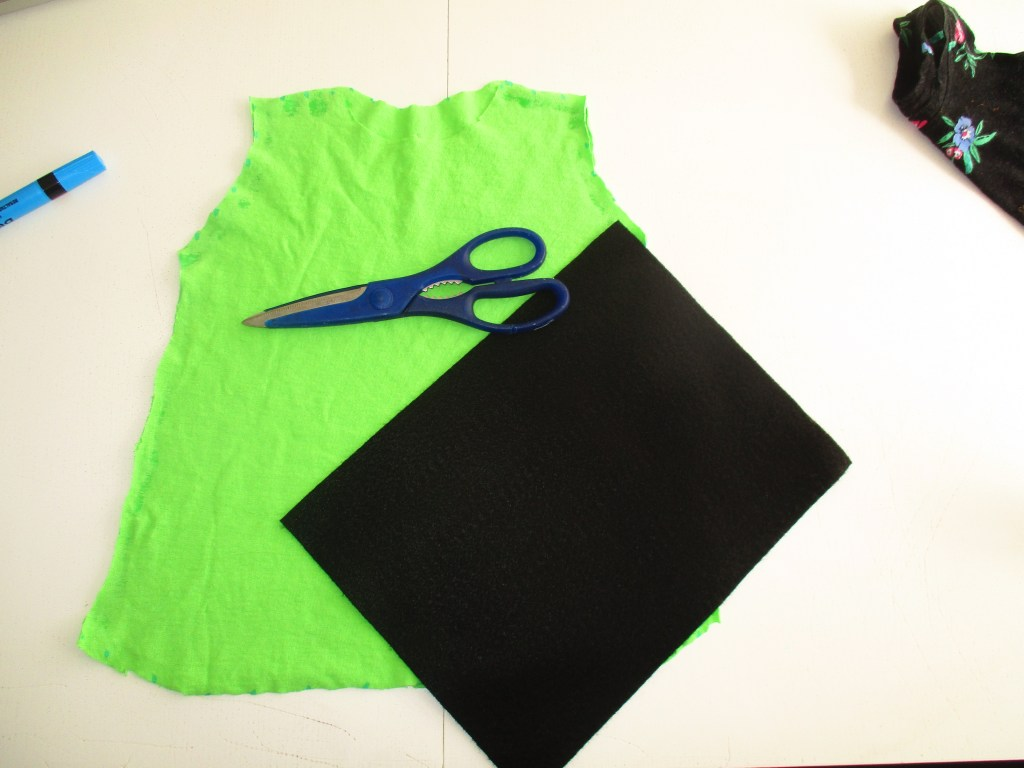 DIY Pebbles Flintstone costume with green shirt and felt for little girls