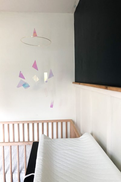 DIY modern iridescent mobile and raw wood ledge board and batten accent wall