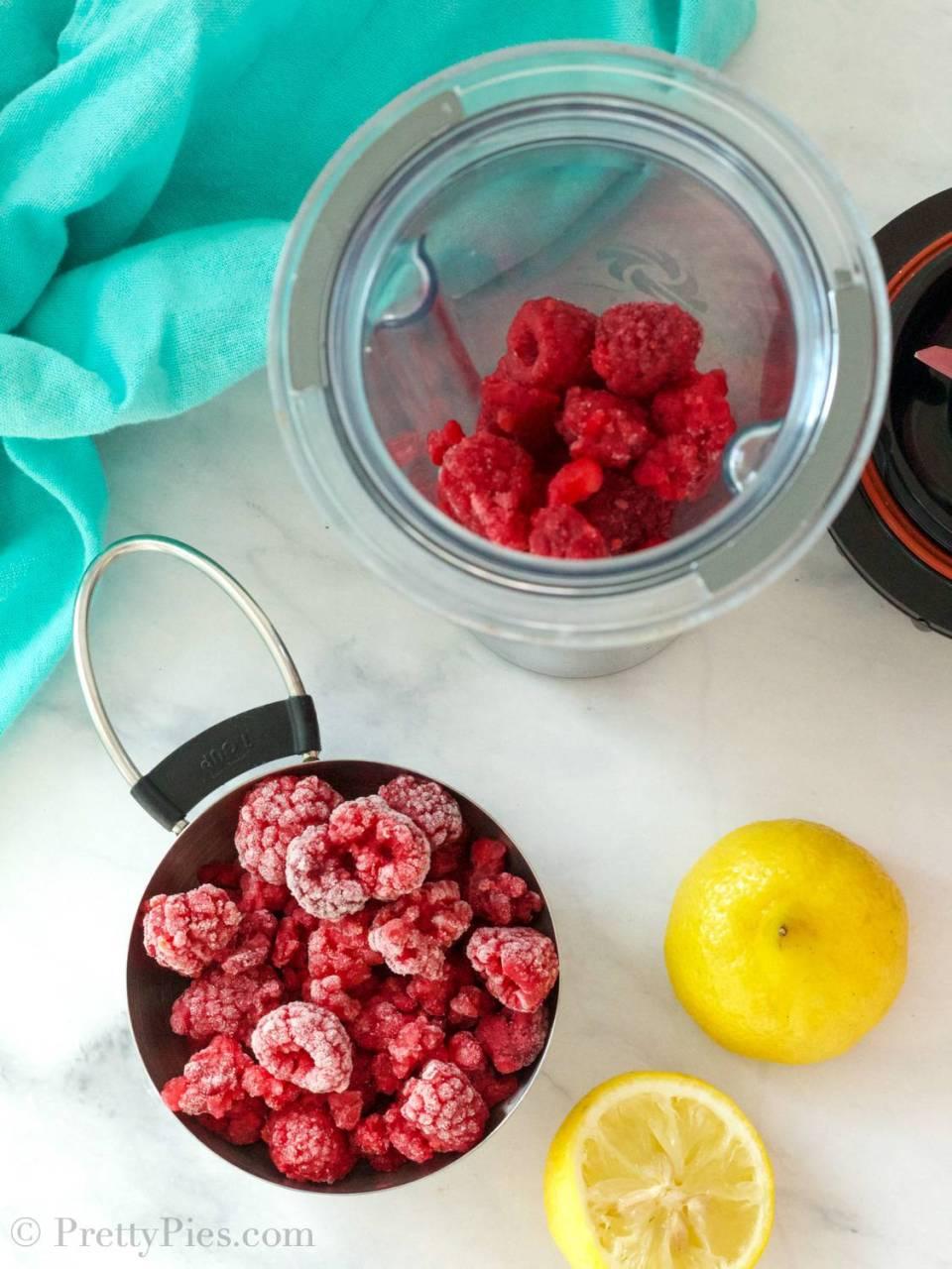 Frozen raspberries in a cup