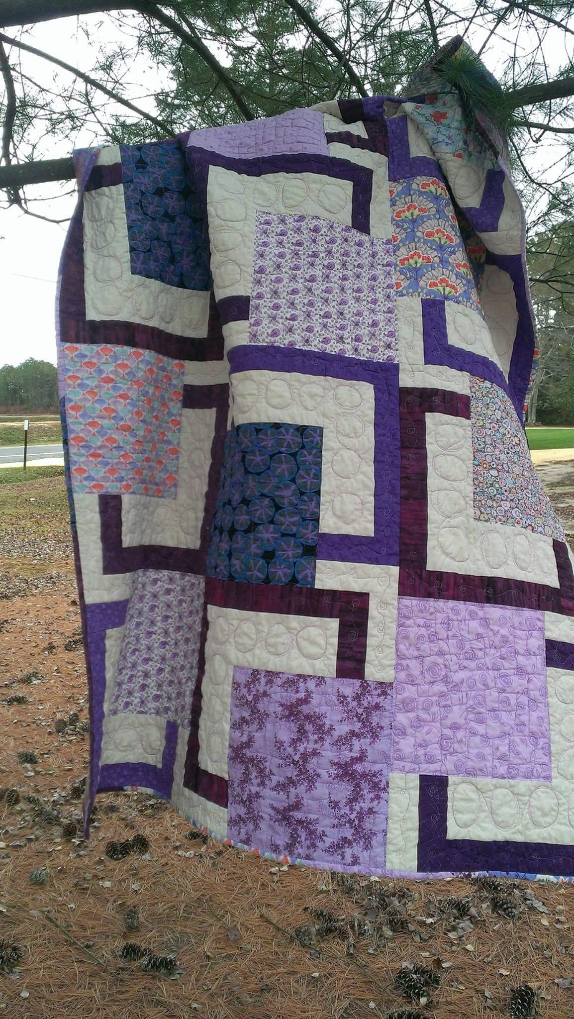 scrappy purple squares on a cream background