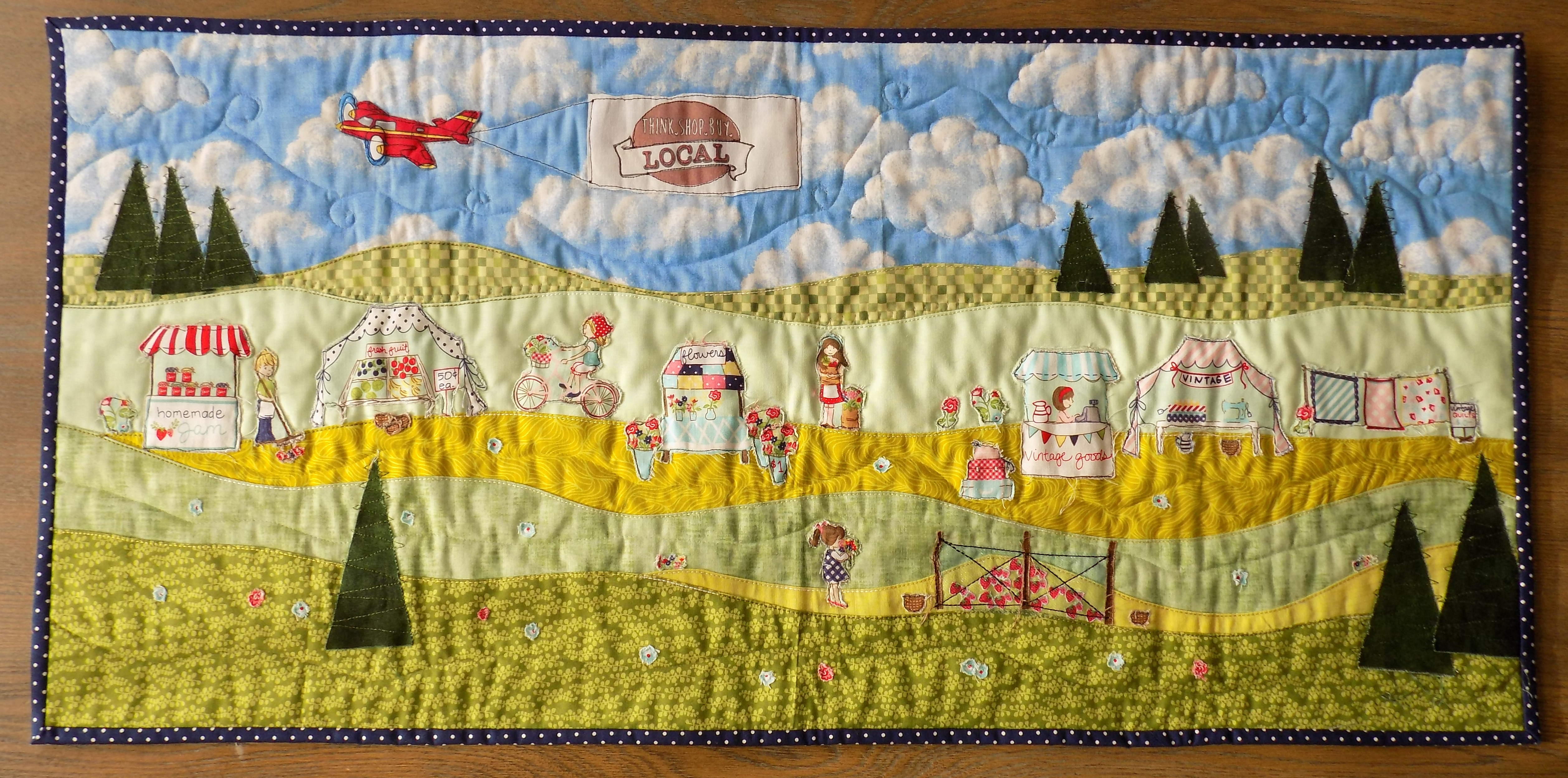 Raw edge applique landscape made from Riley Blake's Vintage Market line