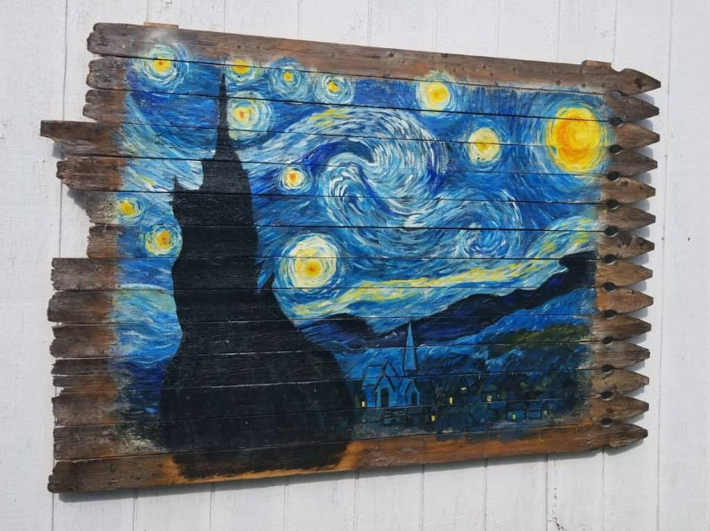 Van Gogh's Starry Night Mural painted on an old fence