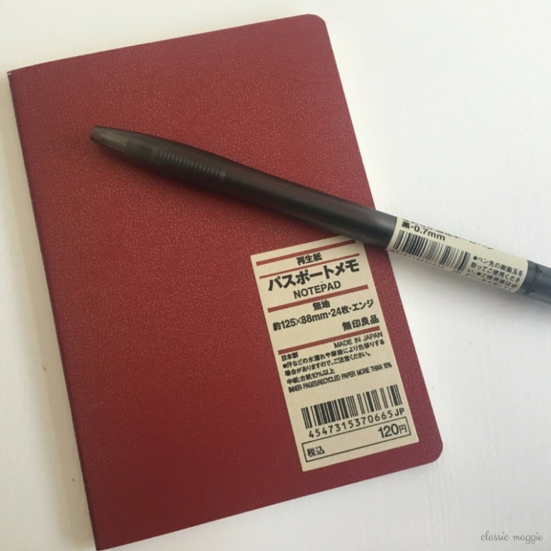 muji notebook and pen