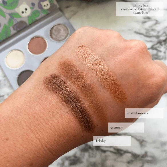 hand swatches of the Winky Lux Cashmere Kitten Palette in the shades Instafamous (Shimmering Golden Amber); Grumpy (Matte Camel Brown); Frisky (Shimmering Golden Brown)