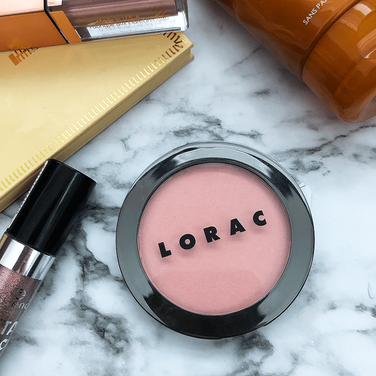 A close up shot of Lorac's ColorSource Buildable Blush in the shade tinge on a white marble background