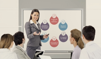 Successful business woman giving a presentation on flipchart