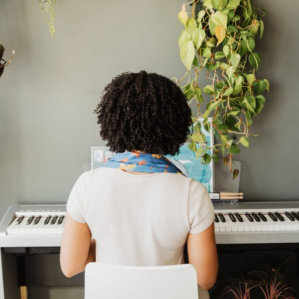sitting-in-front-of-a-piano-keyboard